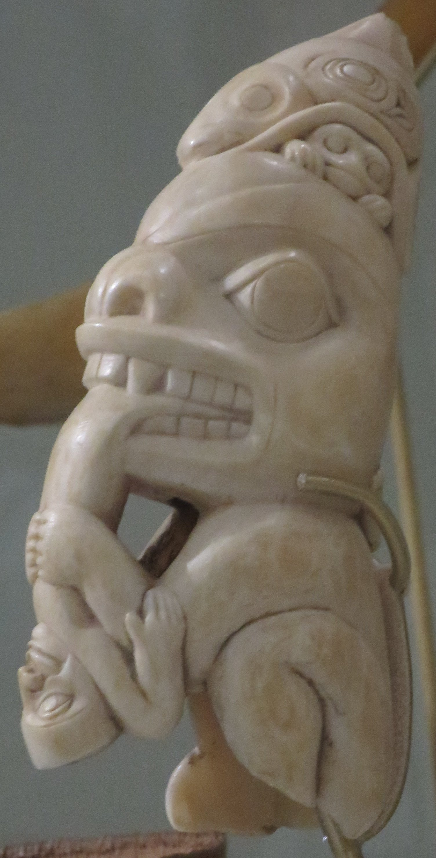 Foot totem pole being carved in situ by haida master artist and