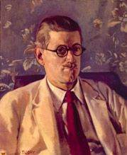 Half-length portrait of a fortyish man wearing distinctive Windsor (circular-lens) glasses with black Zylo-covered frames, short and slicked-down brown hair, a small mustache, light tan jacket and brown tie. His mouth is turned down in a slightly truculent expression