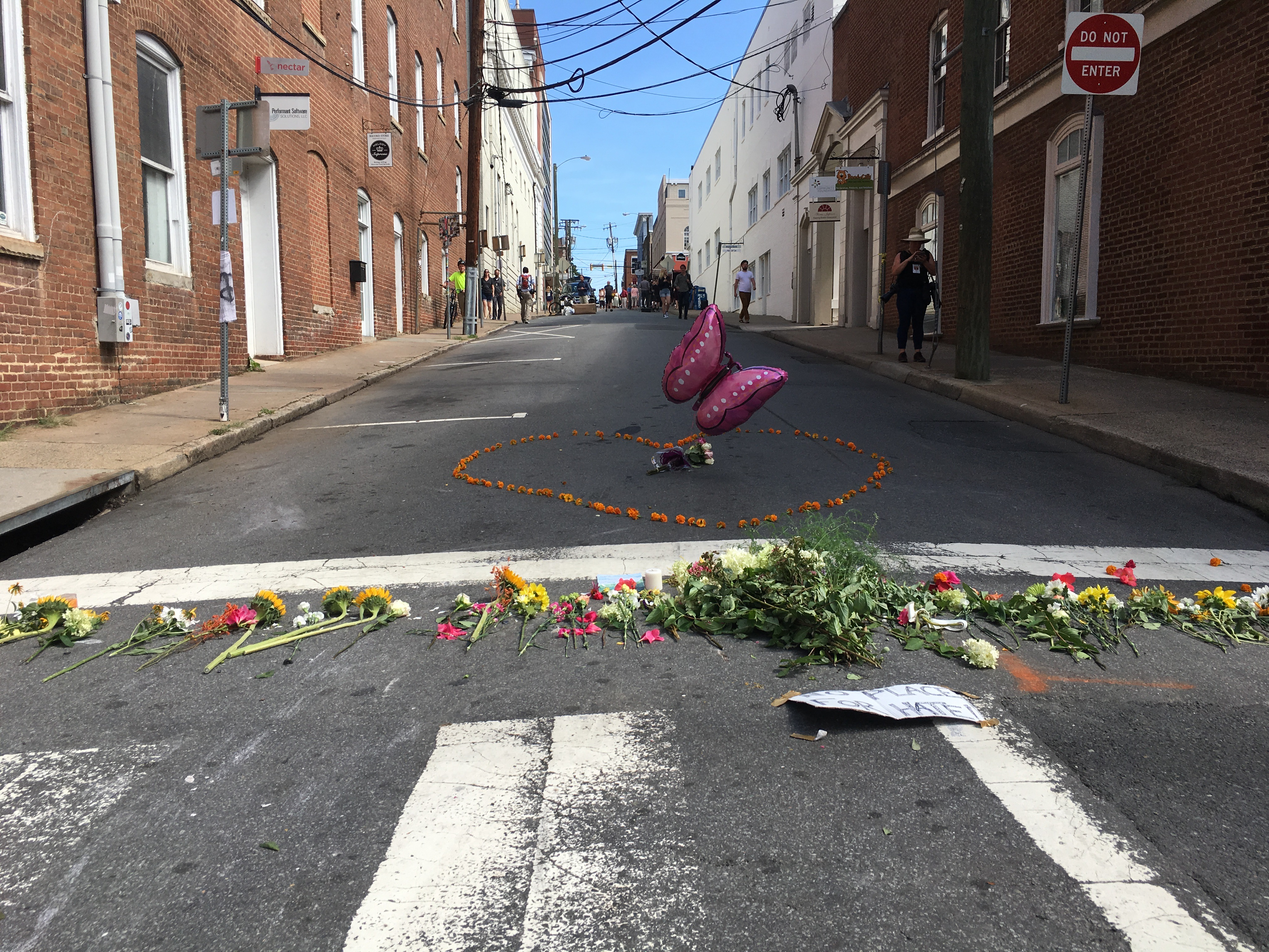 Floral tributes on an empty street