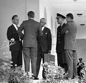 President Kennedy and his advisors discuss the Cuban Missile Crisis. Part of the US response to Soviet missiles being placed in Cuba was a naval blockade of the island.