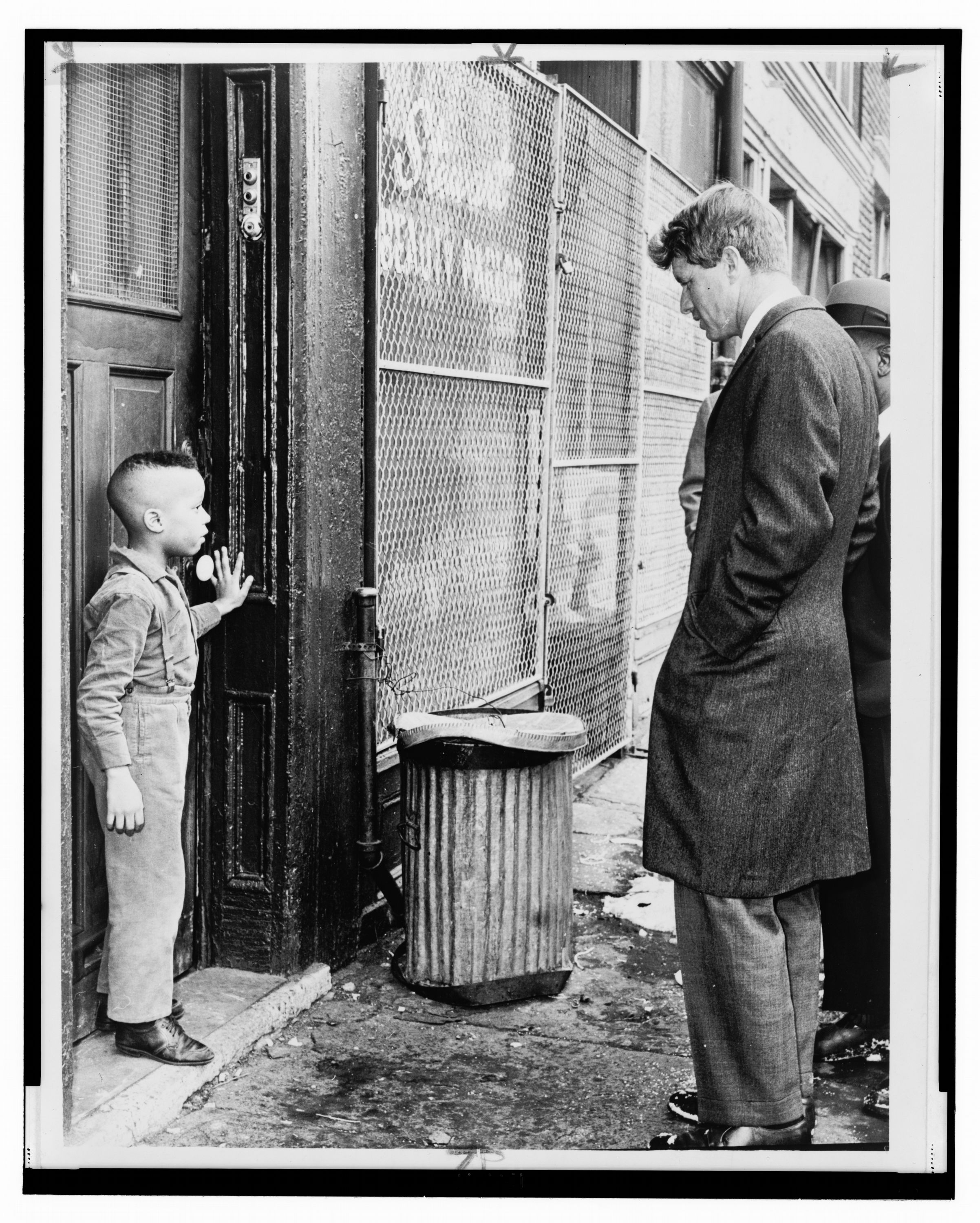 Bobby Kennedy Senator Robert Kennedy discusses school with young Ricky Taggart of 733 Gates Ave