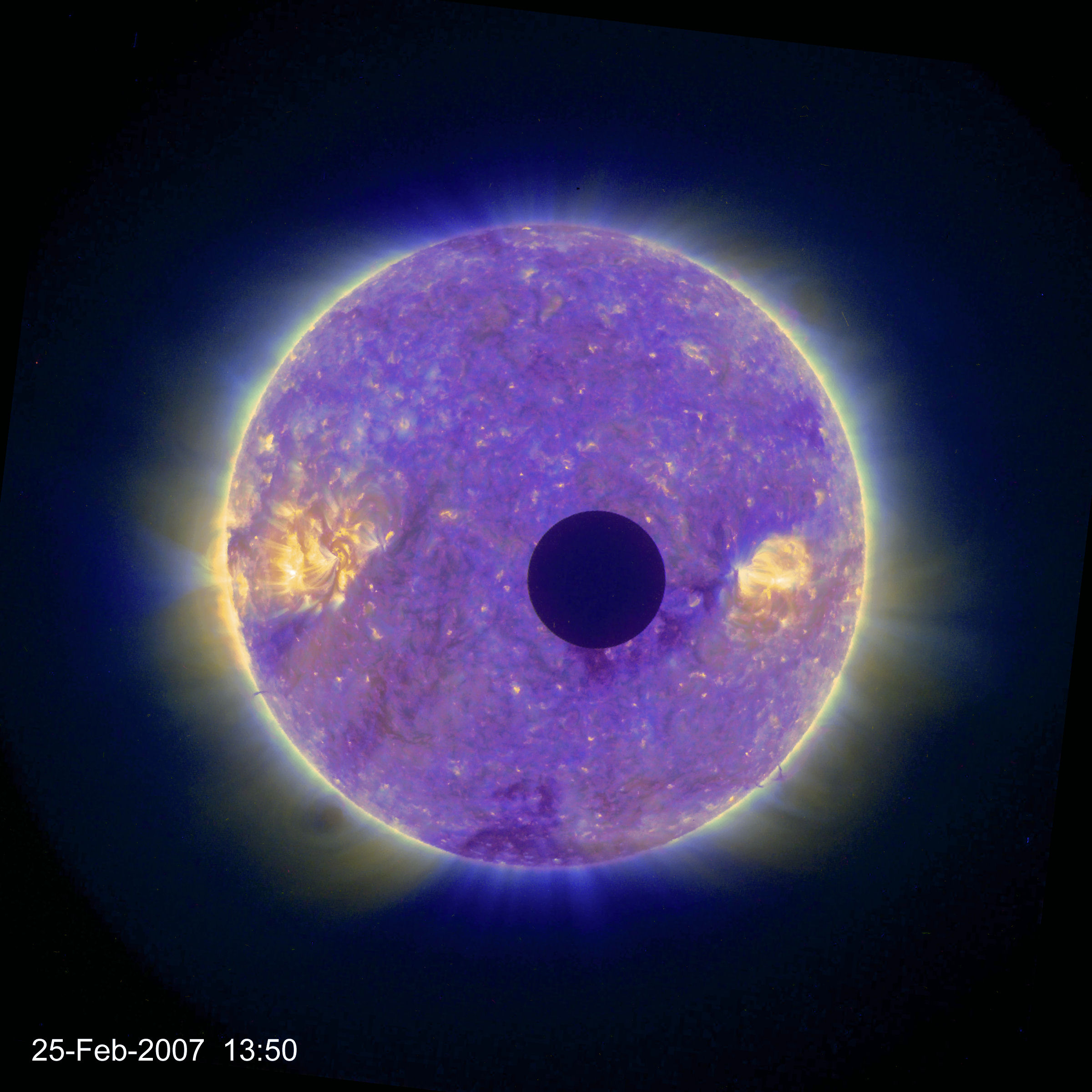 The bright disk of the Sun, showing many coronal filaments, flares and grainy patches in the wavelength of this image, is partly obscured by a small dark disk: here, the Moon covers less than a fifteenth of the Sun.