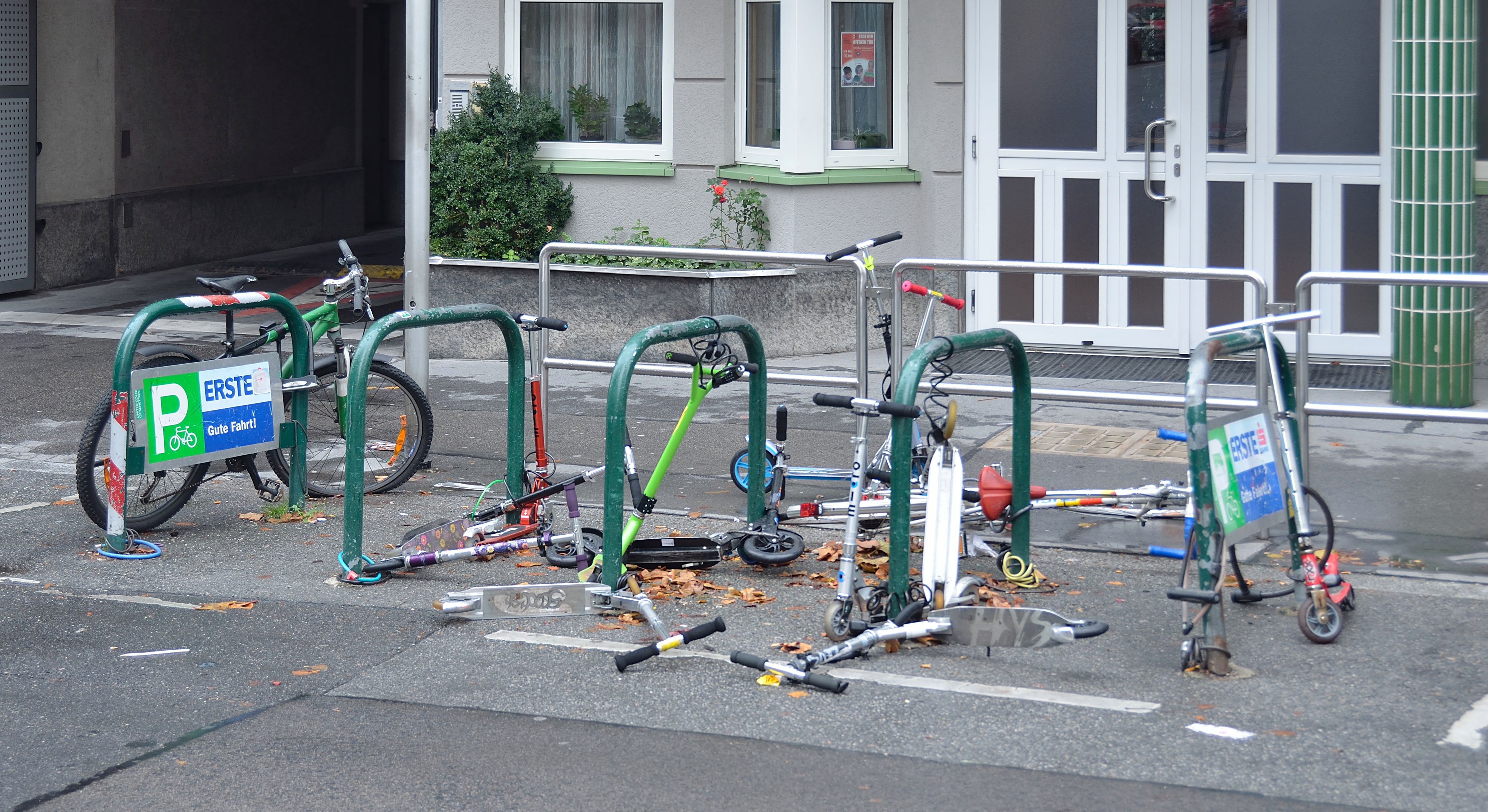 File Scooters On A Bicycle Rack Vienna Jpg Wikimedia Commons