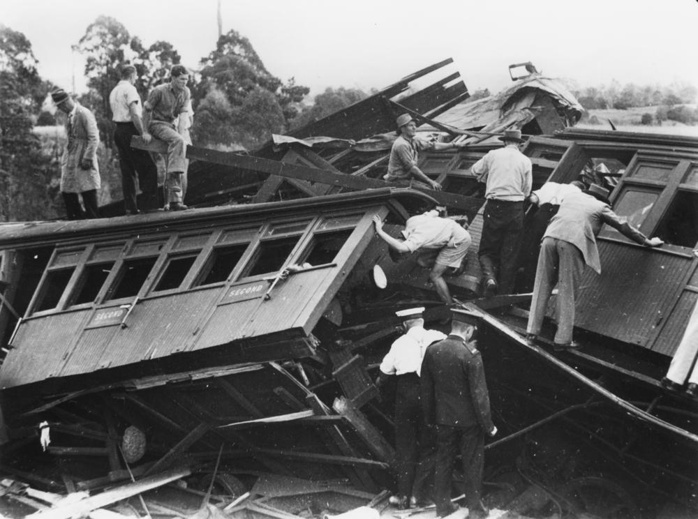 File Statelibqld 2 102560 Rescuers Inspect The Wreckage Of