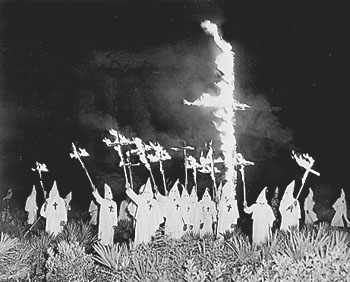 A cross burning by the racist Ku Klux Klan in Florida in the early 20th century. Klan-in-gainesville.jpg