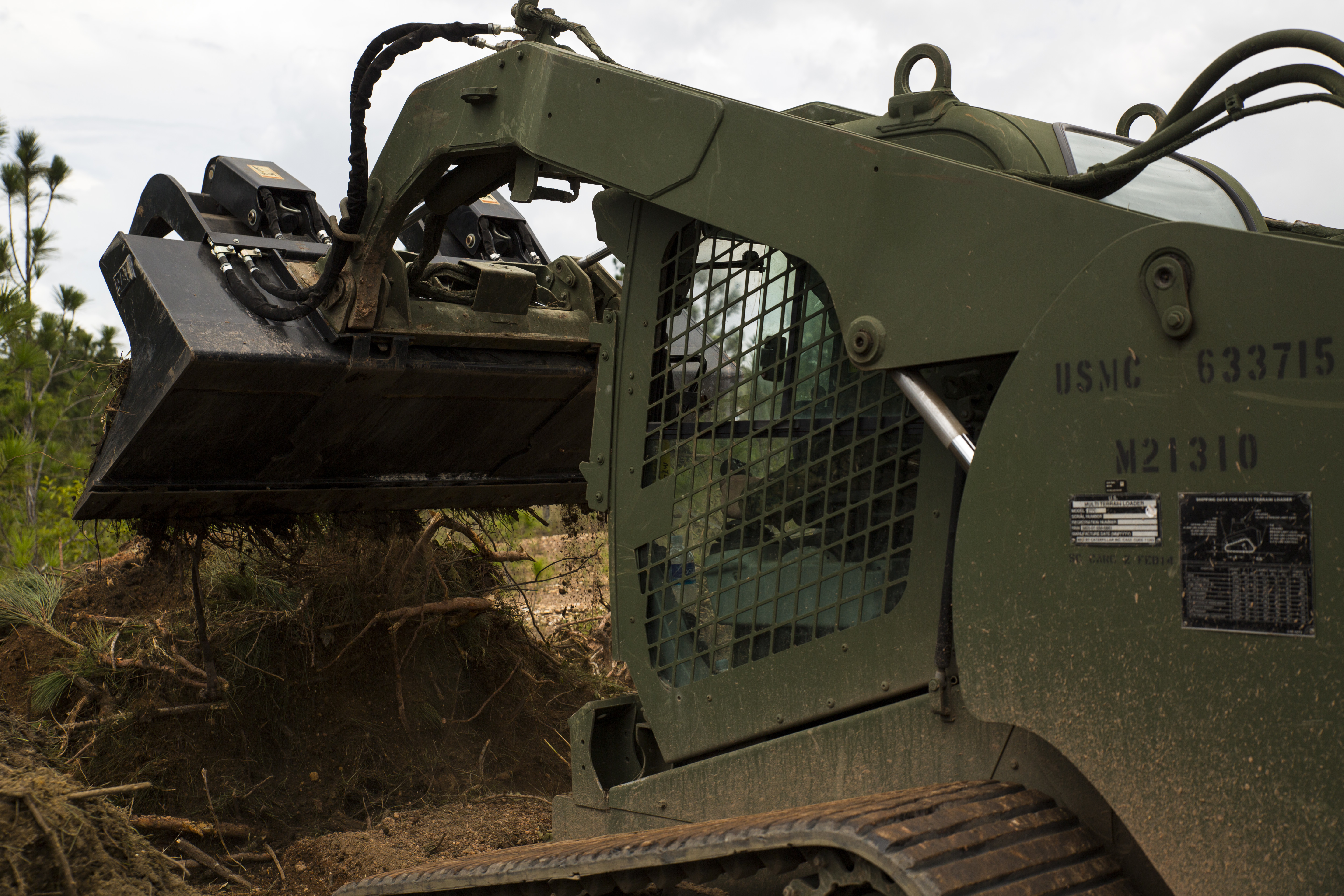 Marines with SPMAGTF-SC renovate, improve Mocoron airfield 150718-M-DK106-036.jpg English: Sergeant Gage Kono, a heavy equipment operator with
