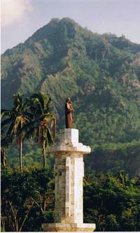 Virgin Mary statue on the foreshore of Pante Macassar looking towards the mountains
