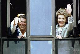 President Ronald Reagan and First Lady Nancy Reagan wave from a Bethesda hospital window after his cancer surgery in 1985. Both would eventually be patients at the hospital again.