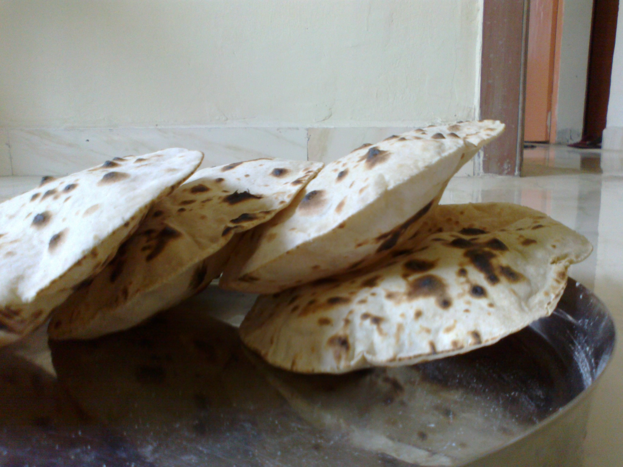 Freshly cooked chapatis once off open-flame.