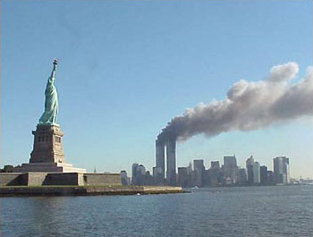 http://upload.wikimedia.org/wikipedia/commons/archive/f/fd/20071030071213!National_Park_Service_9-11_Statue_of_Liberty_and_WTC_fire.jpg