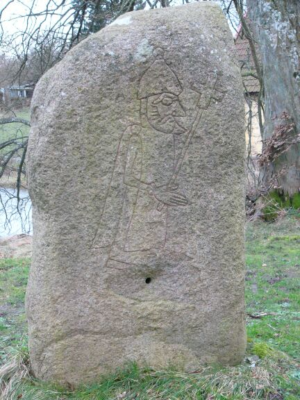 A rune-stone from Søvestad depicting a man carrying a cross, at Wikimedia Commons