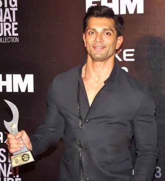 https://upload.wikimedia.org/wikipedia/commons/b/b0/Karan_Singh_Grover_at_FHM_Awards.jpg