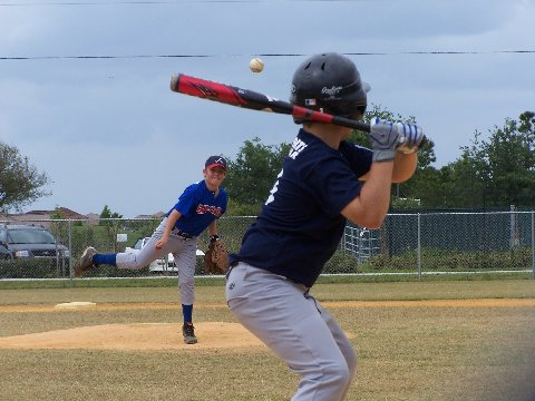 File:Pitcher and batter in youth league.jpg