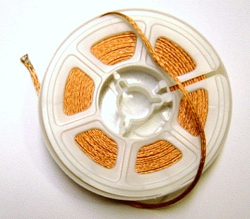 A solder wick on a reel Solder wick rolled.jpg