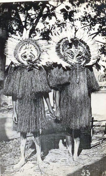 File:Two Papuan Gulf men dressed for ceremony in full body masks, British New Guinea.jpg