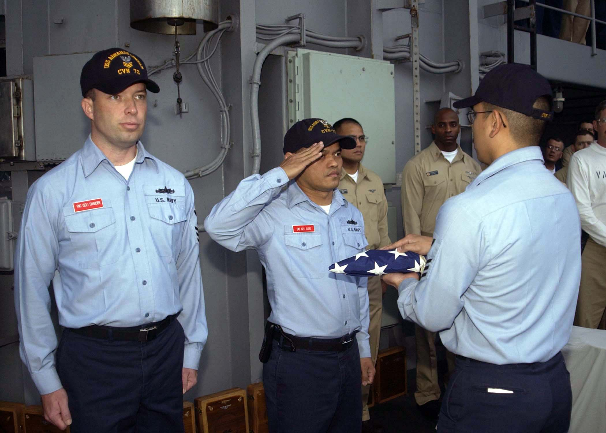 File US Navy 040914-N-0057P-115 Chief petty officer (CPO) selectee s pass  along an American Flag that was draped over a casket full of Dixie Cup  white hats. ... 665cb4b0af8