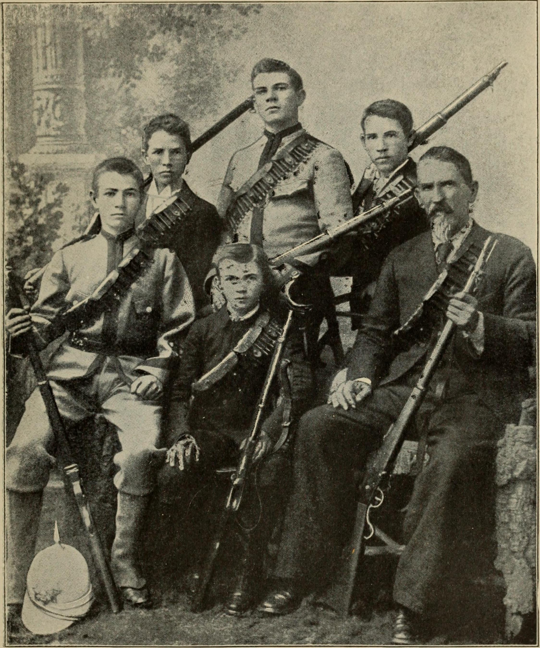 A vintage portrait of the men in a Boer family, all holding their rifles