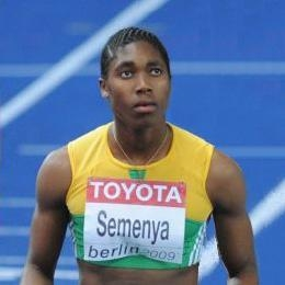 Medium close up of Caster Semenya, the South African sprinter who says she's a woman. The International Association of Athletics Federations isn't sure, so they're forbidding her from competing until they can verify her gender. It's been eight months since they began gender verification tests, in case you're keeping track.