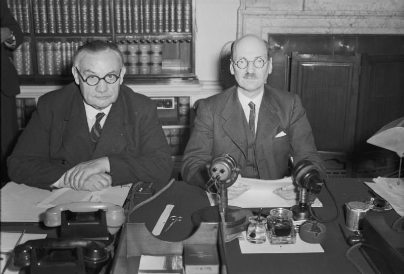 Prime Minister Clement Attlee (right) and Foreign Secretary Ernest Bevin photographed at 10 Downing Street at midnight on 14 August 1945. They had just announced, in a speech broadcast to Britain and the Empire, the news of the Japanese surrender. British Government - This is photograph H 42138 from the collections of the Imperial War Museums.