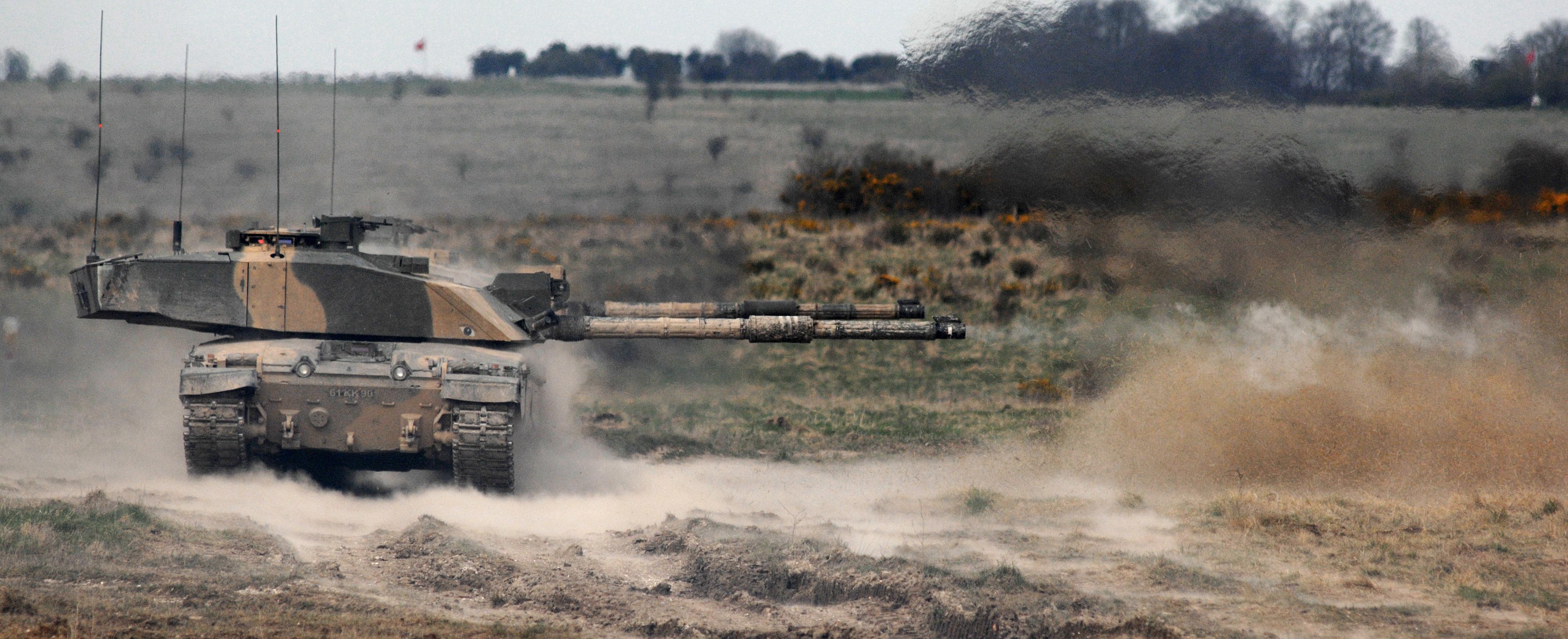 A Challenger 2 Main Battle Tank Fires A High Explosive