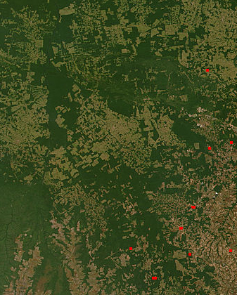 NASA satellite observation of deforestation in the Mato Grosso state of Brazil. The transformation from forest to farm is evident by the paler square shaped areas under development. - 1990s