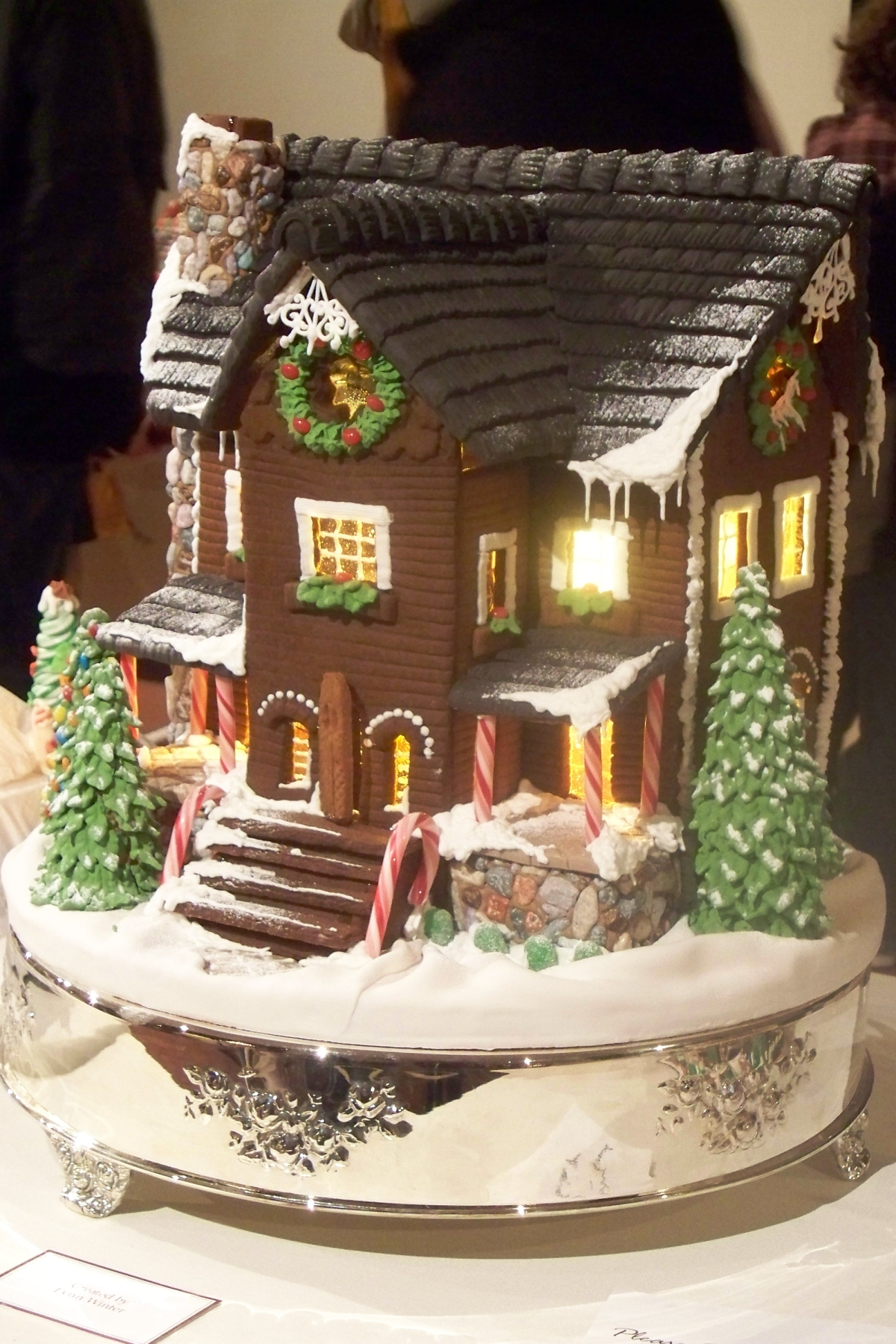 Gingerbread house with steps and trees.jpg