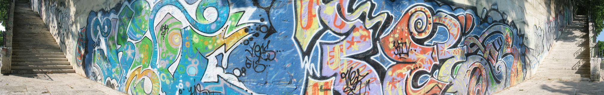 Graffiti on the banks of the Tiber river in Rome, Italy