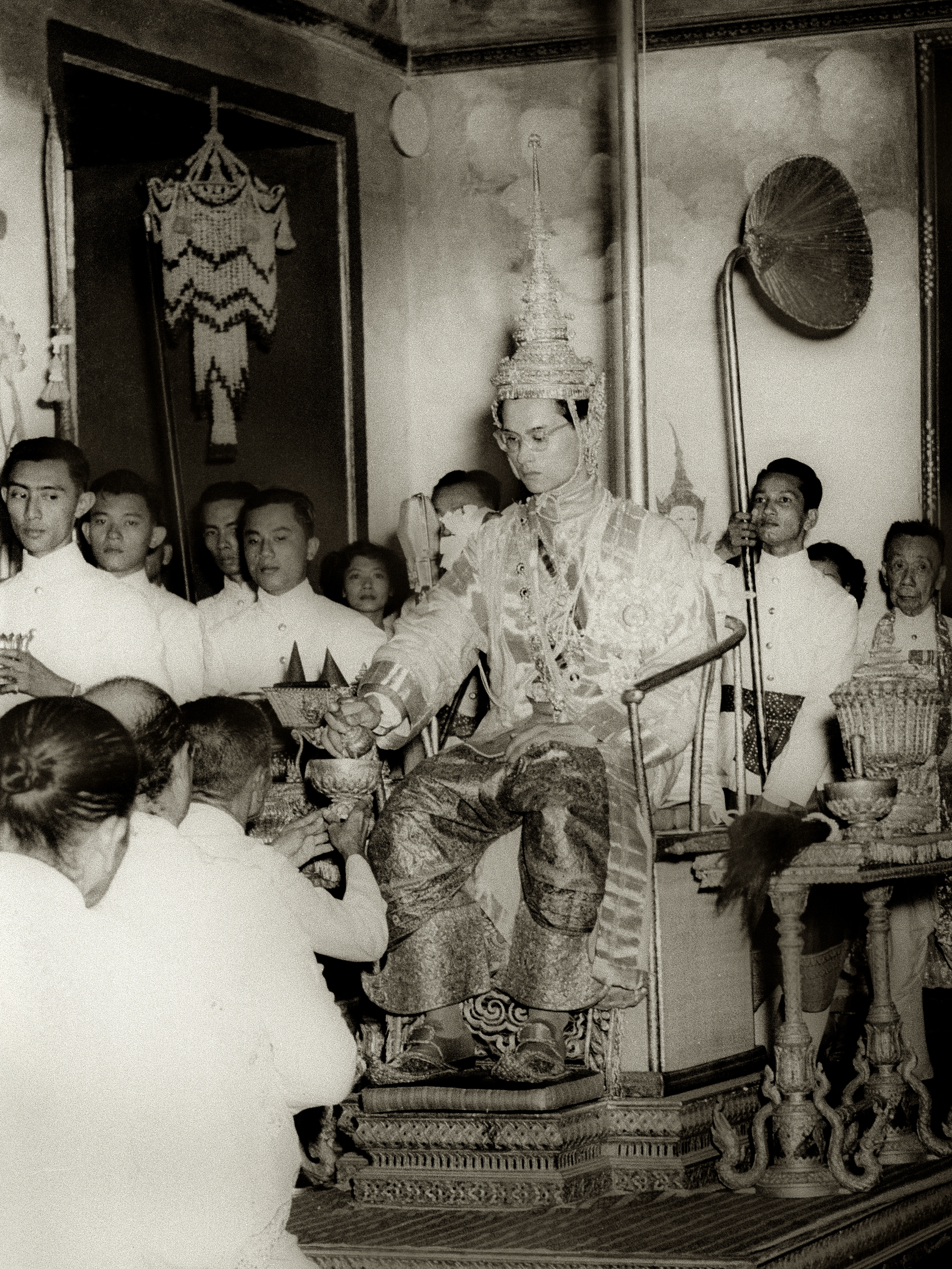 King Rama IX being presented with regalia at coronation image by Wikimedia Commons.