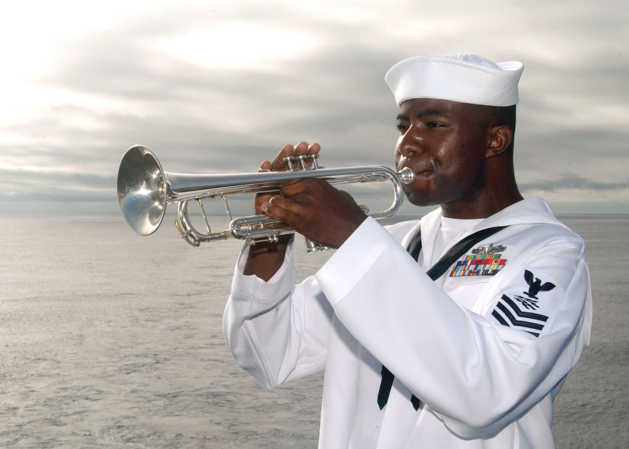US Navy 040718-N-7781D-038 A bugler plays TAPS during a wreath laying ceremony held on the flight deck in memorial of Captain Franklin Hooks II.jpg