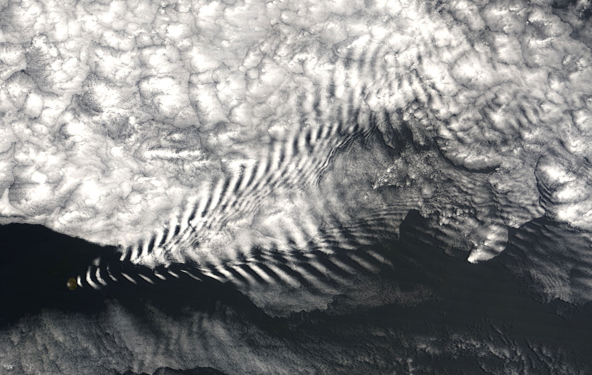 Wave cloud forming off of Amsterdam Island in the far southern Indian Ocean