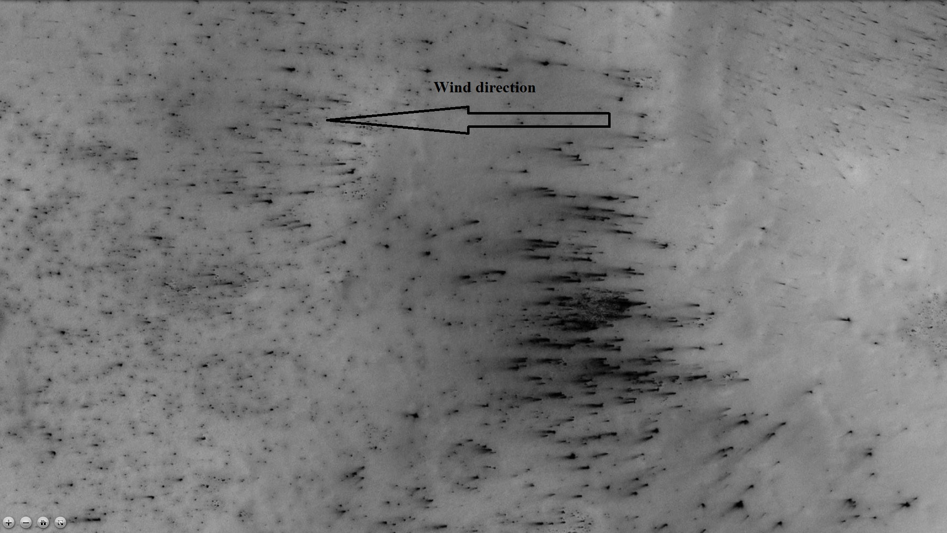 Dust trails in Main crater, as seen by CTX camera (on Mars Reconnaissance Orbiter). Arrow indicates wind direction. In the spring, as the temperature rises, dry ice turns into a pressurized gas, and then blows through a weak spot and carries with it dust. If there is a wind, the dust is deposited in an elongated form as in this image.