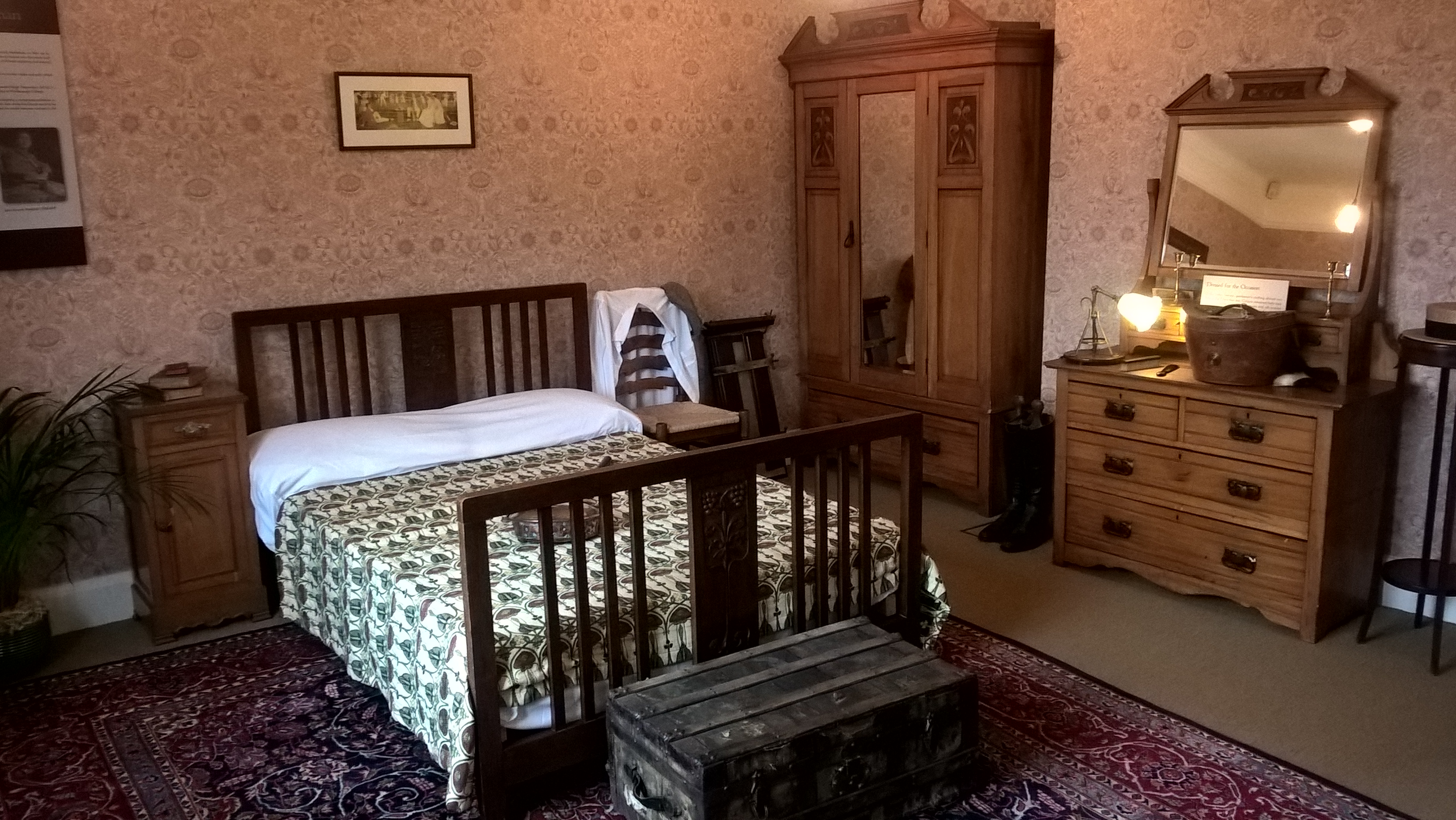 English: Interior of Winterbourne House. Main bedroom. Double bed, chest of drawers with mirror, wardrobe and bedside table. Date 2 March 2016, 10:08:47