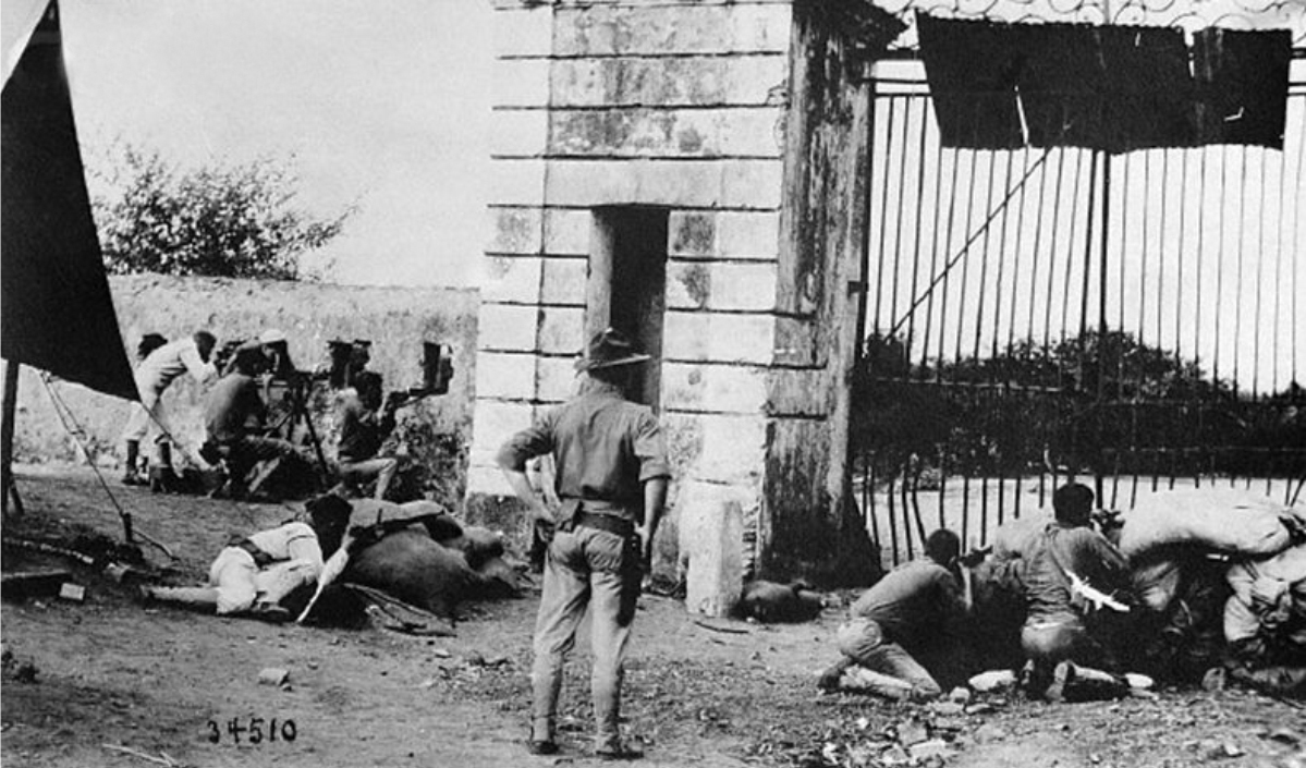 Black white photo of soldiers defending a gate