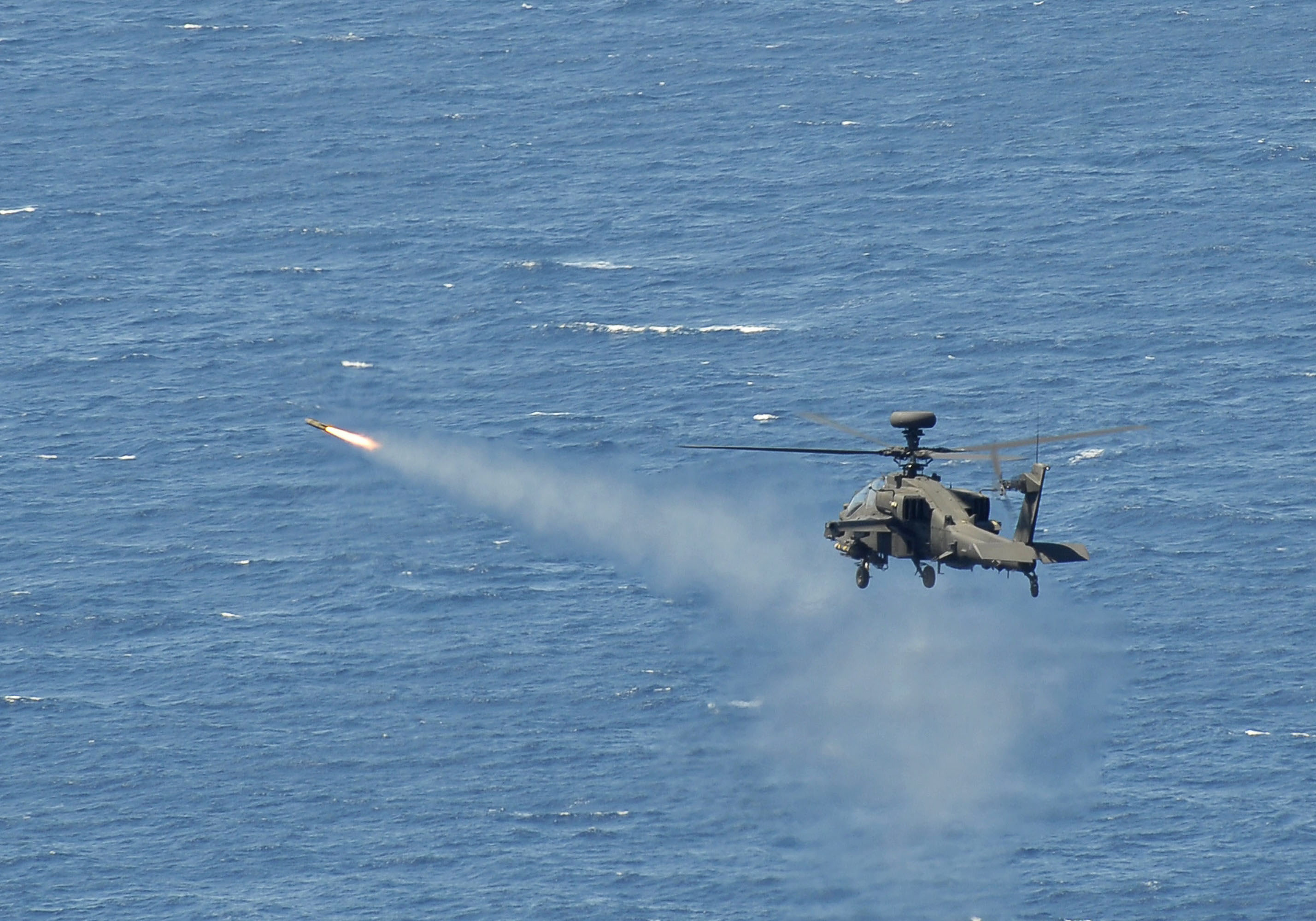 File:Army Apache Helicopter Fires Hellfire Missile During ...