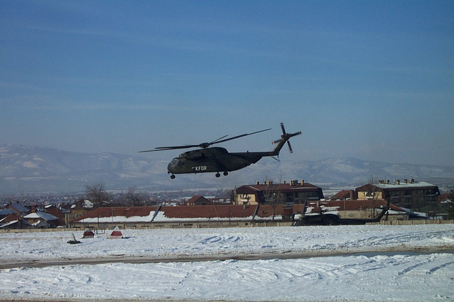 A German army CH-53 heavy lift helicopter takes off at a snow covered Topliçan in January 2002