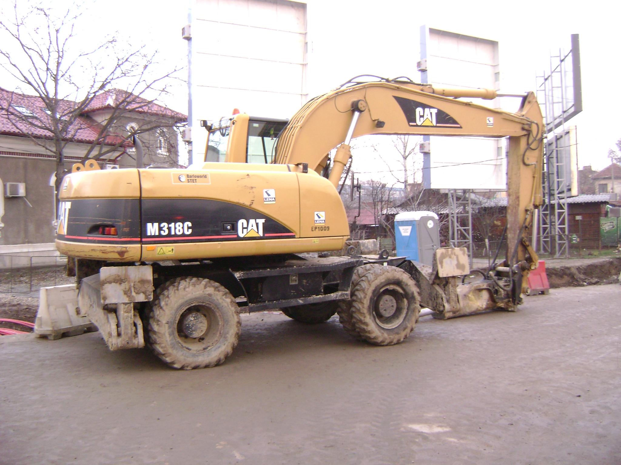 File:Caterpillar M318C wheeled excavator with hydraulic ... on