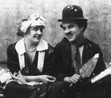Chaplin and Edna Purviance, his regular leading lady, in Work (1915) Chaplin and Purviance in Work.jpg