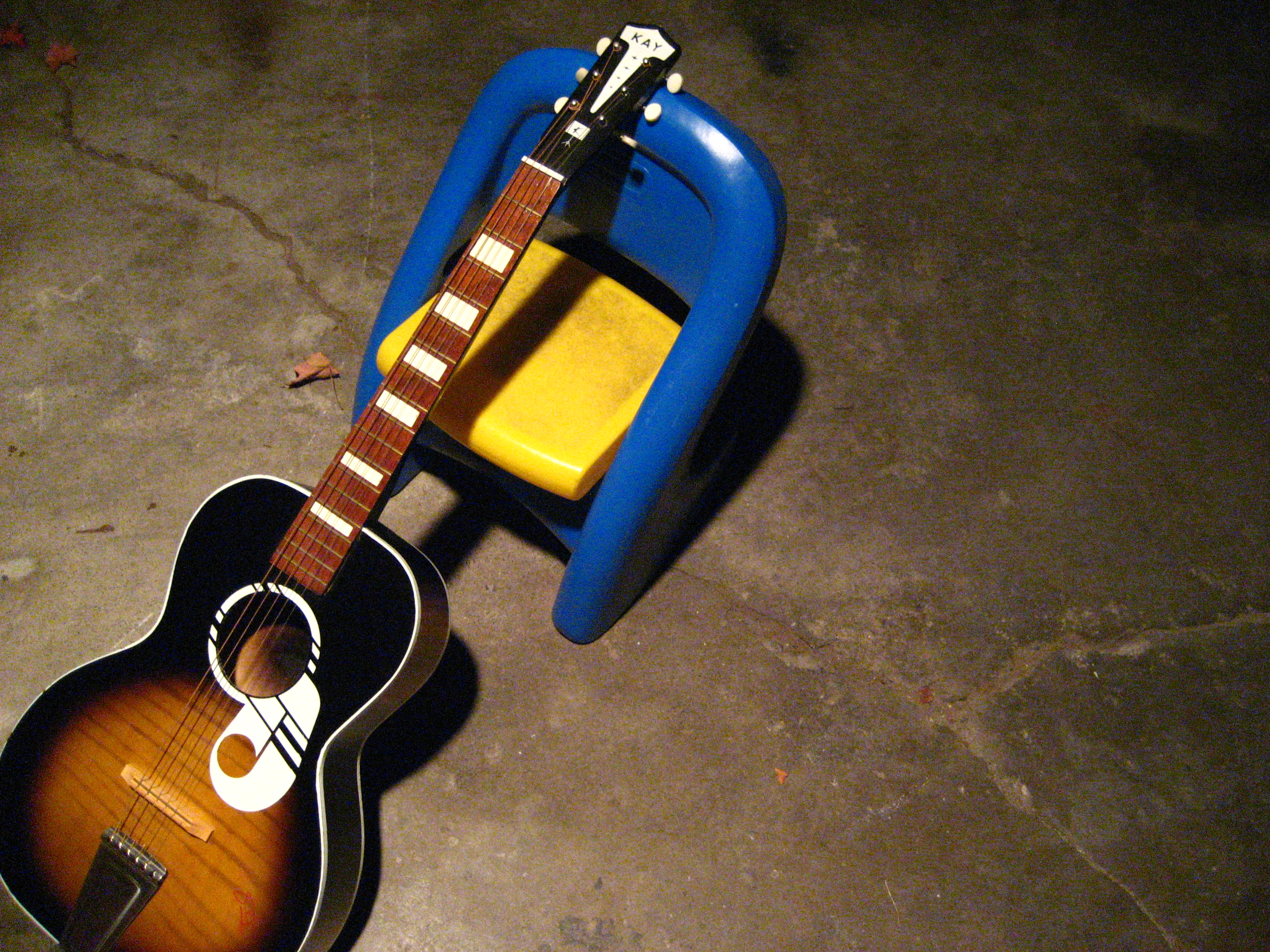 File KAY acoustic guitar on chair Wikimedia mons