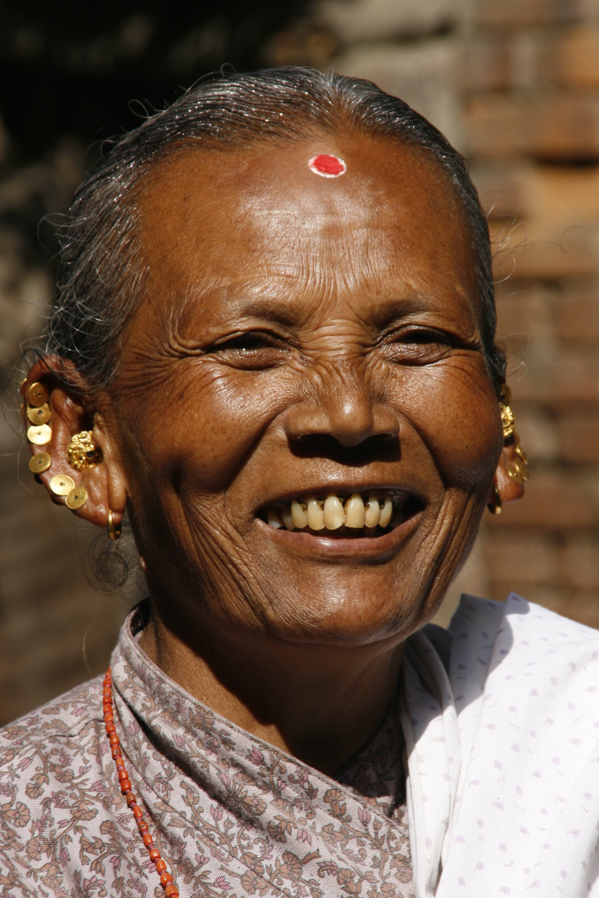 This is apparently the best image of a smile that Wikipedia can find.