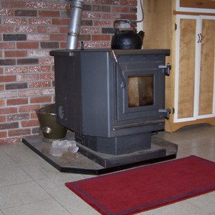 File:Pellet stove with kettle.jpg - Wikimedia Commons