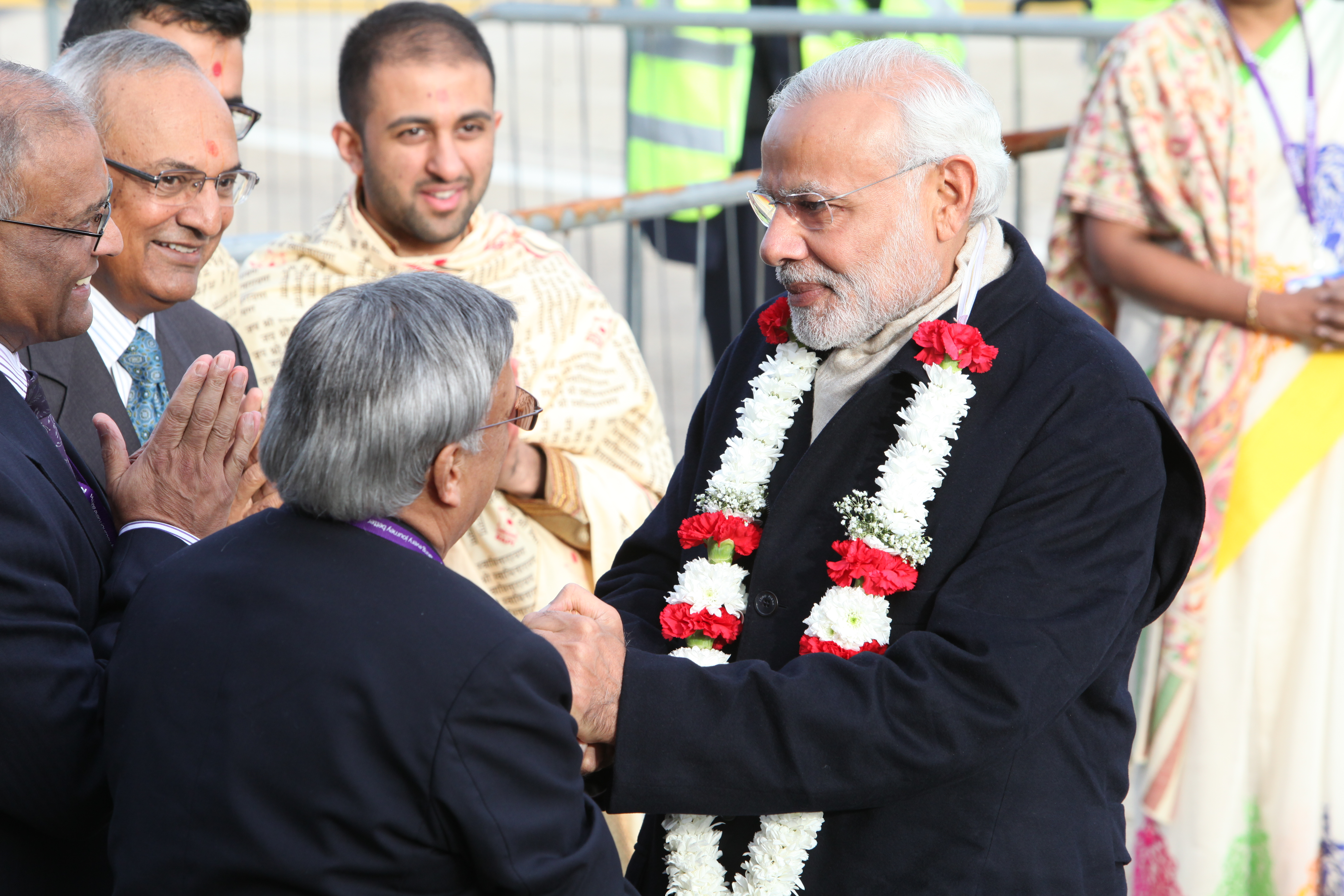 the best attitude c69ed 91dbc File Prime Minister Narendra Modi is presented with a garland of blossoms  after arriving at Heathrow Airport, London.jpg