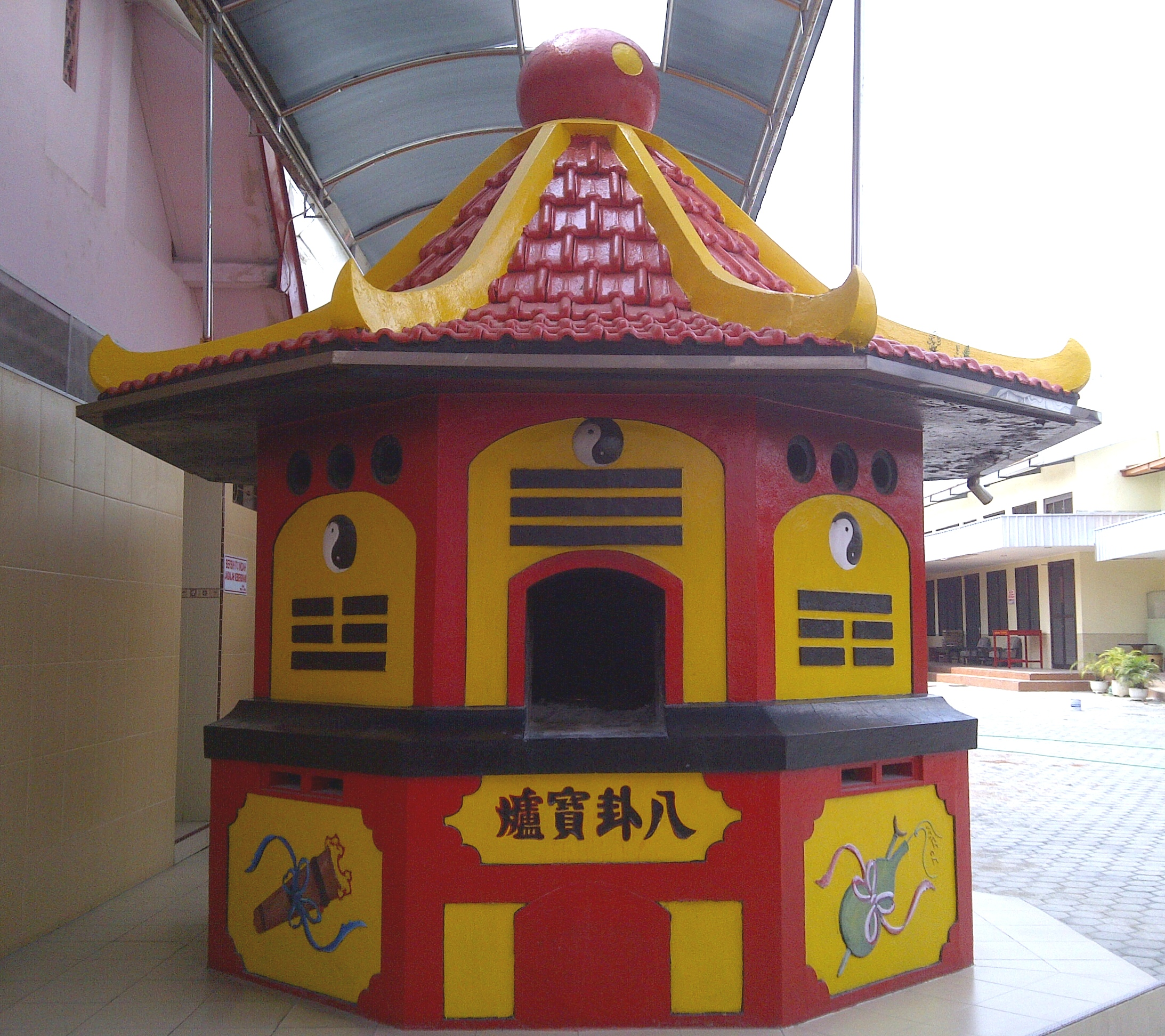 file stove building for burning paper at chinese temple of tik liong