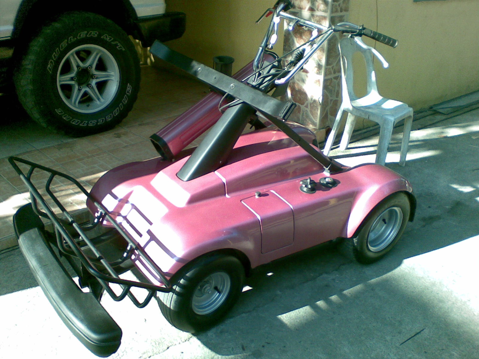 File:Yamaha pink golf cart.jpg - Wikimedia Commons on gasoline carts, used carts, ezgo carts, yamaha side by side, custom lifted carts, yamaha passenger carts, yamaha electric carts, gas powered carts, yamaha gas carts, yamaha trailers, yamaha utility,