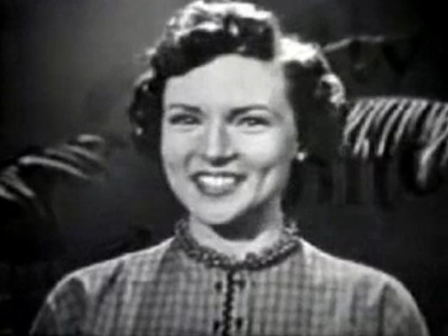 a black and white cropped screenshot of Betty White smiling in the television series, The Betty White Show in 1954