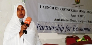 Qani Abdi Alin, owner of the Dheeman clothing firm, at the launch of the Partnership Fund for local commercial ventures.