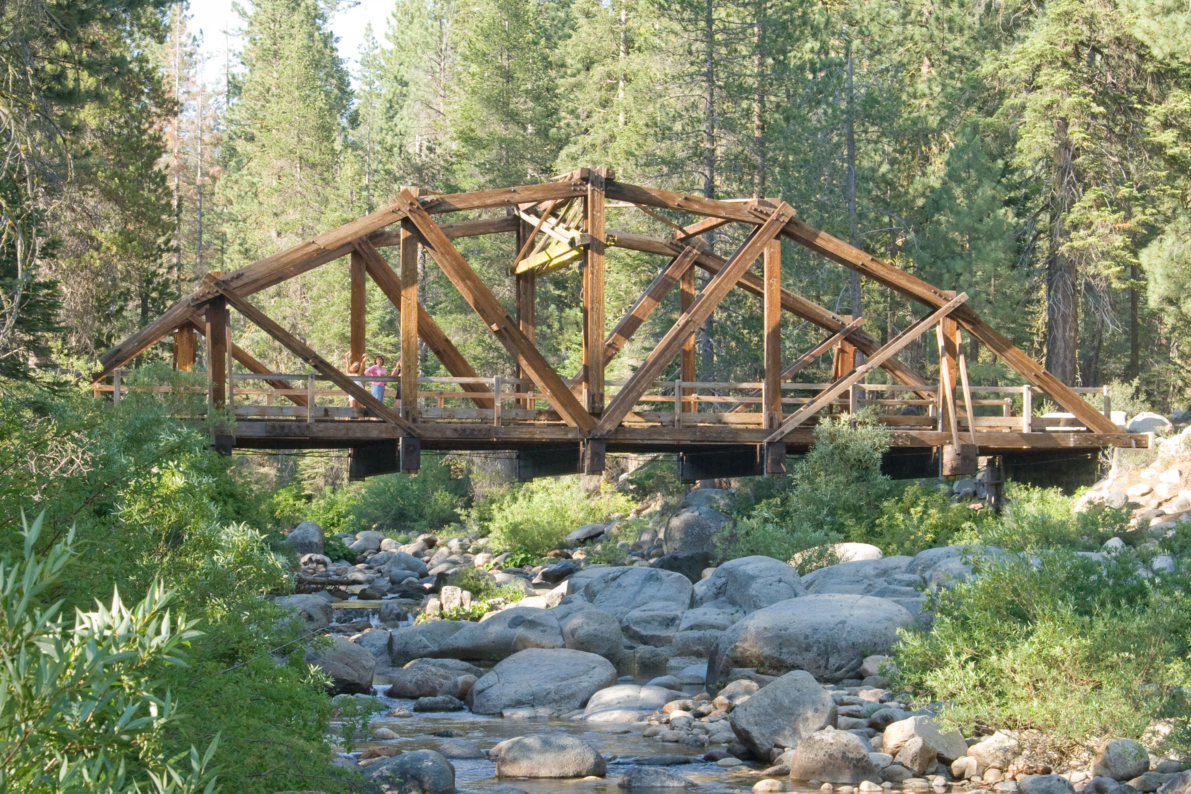 Build wooden bridge over creek