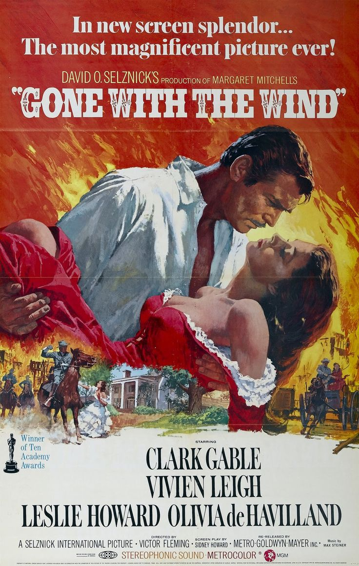 gone the wind film  poster shows rhett butler carrying scarlett o hara against a backdrop of the burning of