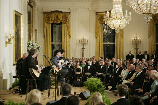 Kenny Chesney performing in the East Room of the White House on May 16, 2006, at the official dinner for Australian Prime Minister John Howard and Mrs. Janette Howard Kenny Chesney performs in the East Room of the White House.jpg