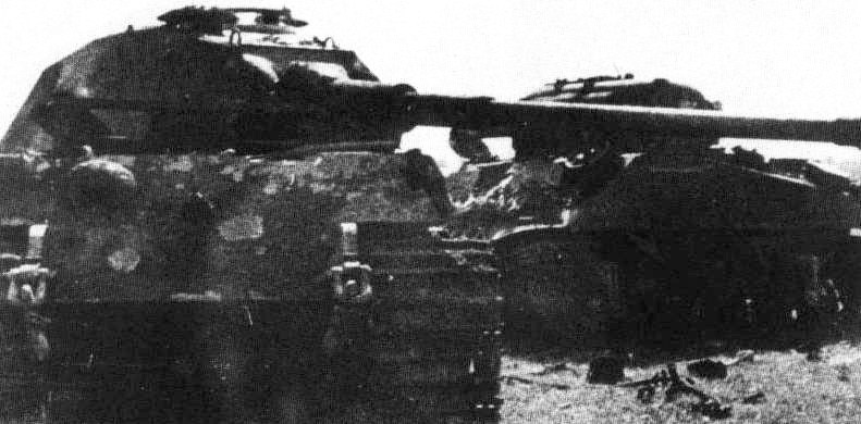 A British Sherman rams a King Tiger
