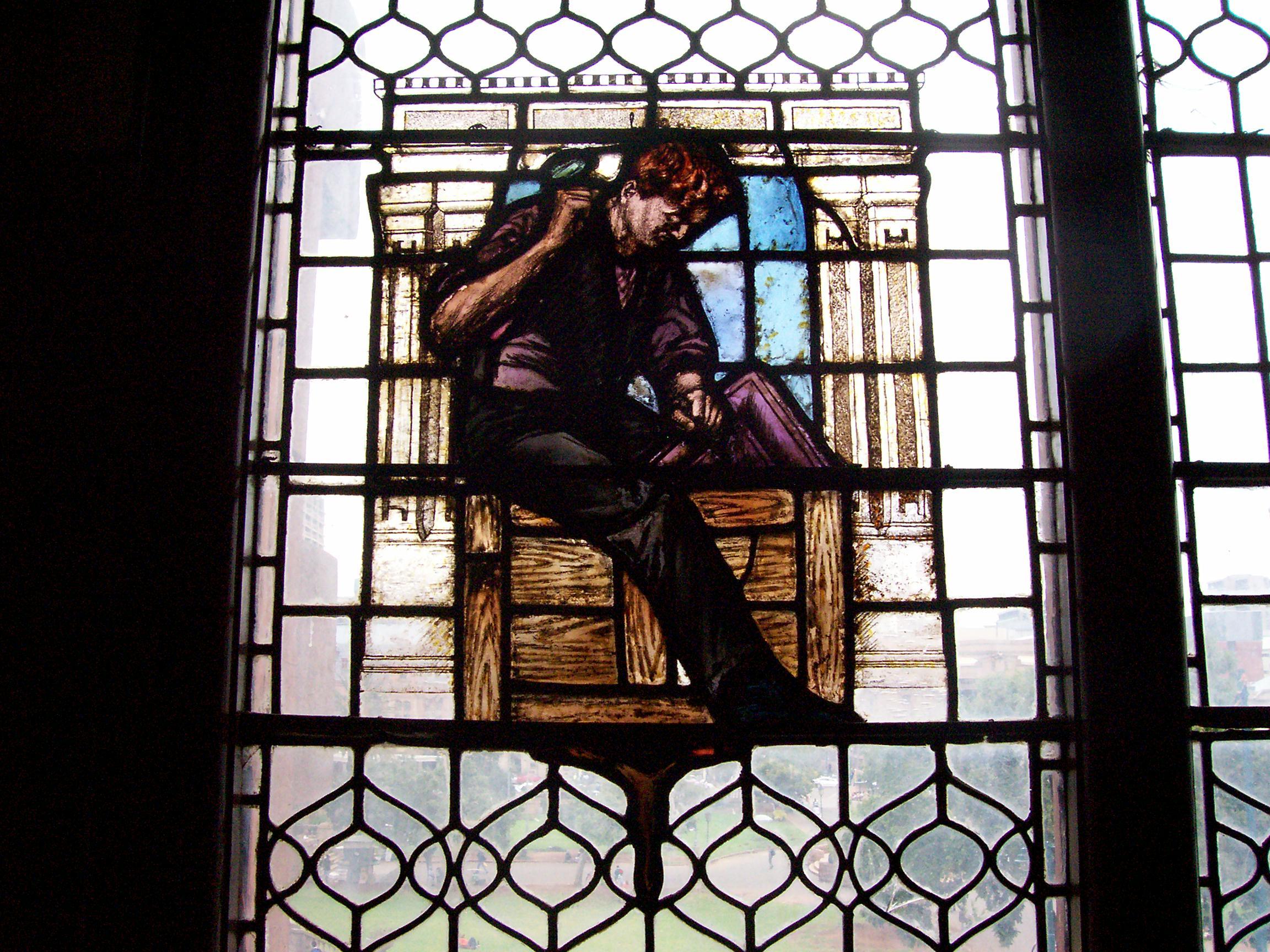 file male figure in stained glass window  tudor chambers  church square  pretoria jpg